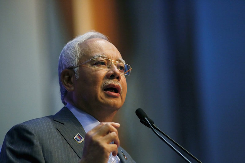 Malaysian Prime Minister Najib Razak speaks at a news conference to announce budget revisions to help its oil exporting economy adjust to the impact of slumping global crude prices, in Putrajaya, in this file picture taken January 20, 2015. Razak will outline on May 21, 2015 a five-year development plan leading up to 2020, the date the country has set for achieving developed economy status, but that goal may prove elusive as political pressures crowd out reform.   REUTERS/Olivia Harris